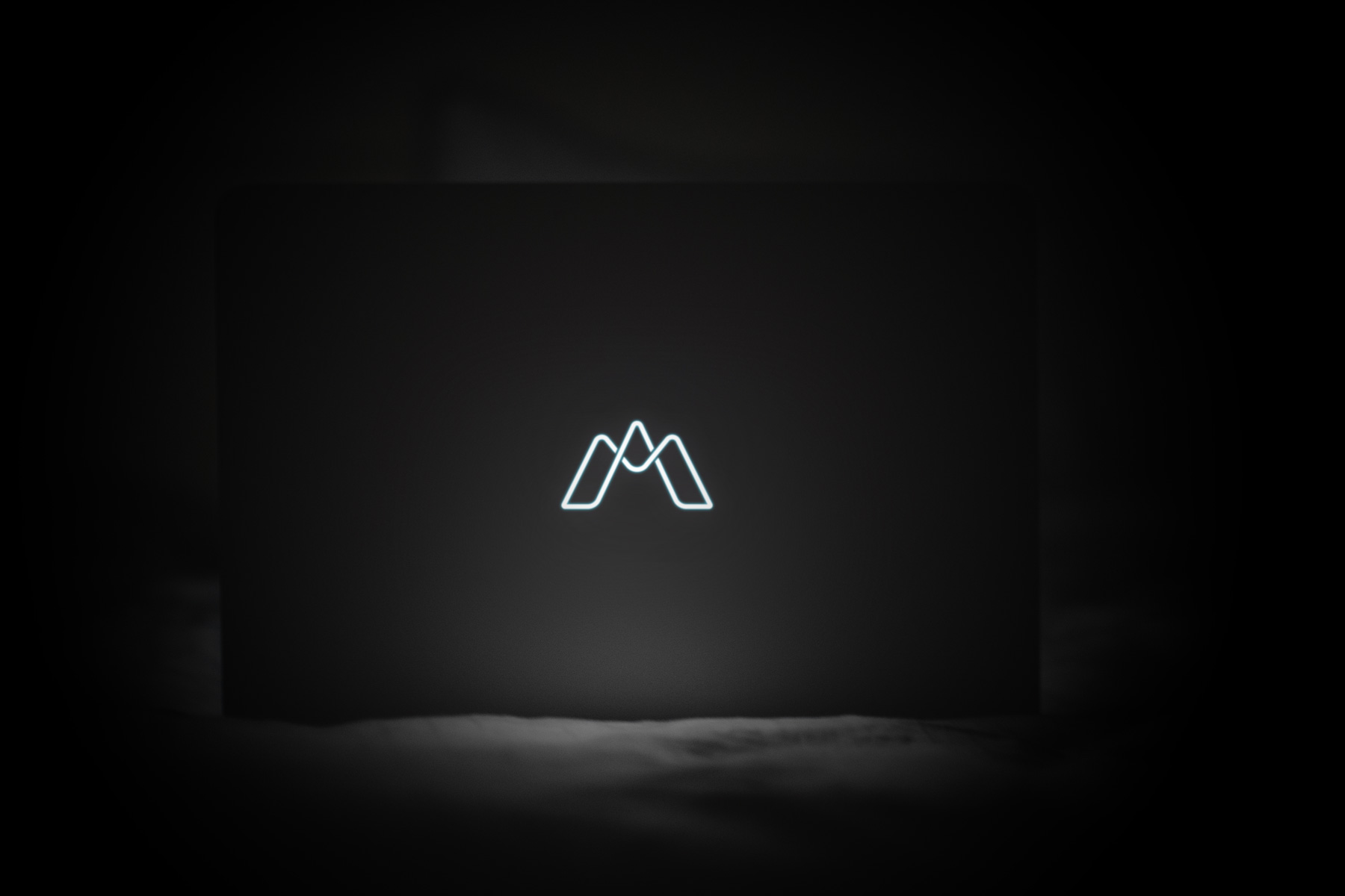 the infinite monkey lab logo design on a computer in the dark
